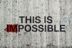 This Is Impossible Concept. With Graffiti on Gray Cement Street Wall royalty free stock image