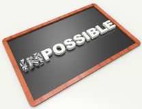 Impossible is nothing. 3d word concept on blackboard Royalty Free Stock Image