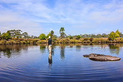 Impossible is nothing. The man standing on the natural ponds Royalty Free Stock Image