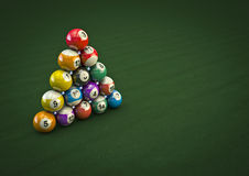 Impossible pool ball trick. 3D render of pool balls in a physically impossible formation Royalty Free Stock Photography