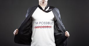 Impossible into possible, young successful businessman Royalty Free Stock Photography