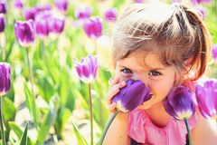 Impossible scent. face skincare. allergy to flowers. Summer girl fashion. Happy childhood. Little girl in sunny spring royalty free stock images