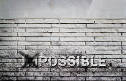 Impossible text on gray brick wall, business concept Stock Image