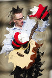 Impossible to do. Businessmen playing on guitar wearing boxing gloves, splashed in a mud.  Stock Photos