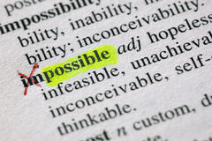 From the impossible to the possible. The word possible highligted from impossible in a dictionary Royalty Free Stock Photos