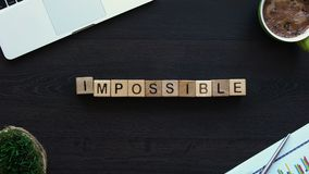 Impossible to possible, hand putting word of cubes, motivation for development