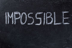 Impossible written on blackboard Royalty Free Stock Image