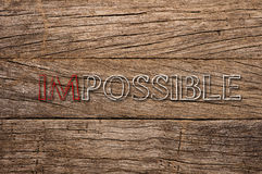 Impossible written on wooden background Stock Photography