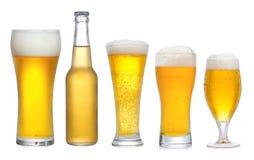 Imposti con differenti vetri della birra Fotografia Stock
