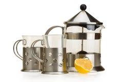 Imposti per tè da un vetro e da un metallo Fotografia Stock Libera da Diritti