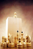 Impostor. Chess pawn on the top. Conceptual image with chess pieces Royalty Free Stock Images