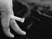Impotency papierosem fotografia stock