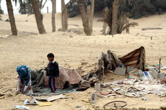 Poor Bedouin Child in Egypt. Illustrates the depth of poverty in this population, contributing to social unrest and uprising.  Poor Bedouin child in desert Royalty Free Stock Photo