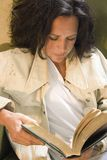 Impoverished Woman Reading stock images
