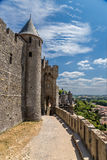 Impregnable medieval fortress in Carcassonne, France. UNESCO list. Fortress of Carcassonne - a medieval architectural complex, located in the French town of Royalty Free Stock Photo