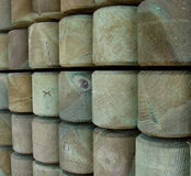 Impregnated wood piles. Stack with green impregnated wood piles Royalty Free Stock Photo