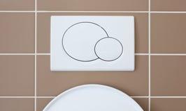 Imprensa econômica do resplendor do toalete imagens de stock royalty free