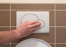 Imprensa econômica do resplendor do toalete Fotos de Stock Royalty Free