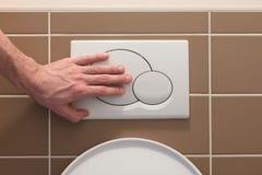 Imprensa econômica do resplendor do toalete Foto de Stock