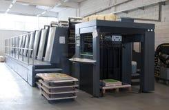 Impresión de la prensa - máquina compensada fotos de archivo