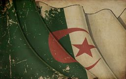 Impresión de papel vieja - bandera que agita de Argelia fotos de archivo