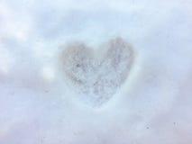 Impresión del corazón en la nieve Foto de archivo