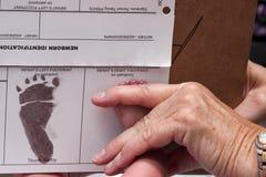 Impresión del pie de los recién nacidos Fotos de archivo libres de regalías