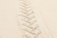 Impresión en el fondo y la textura de la arena Fotografía de archivo