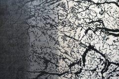 Impresión gris de la pendiente con las curvas negras en tela foto de archivo libre de regalías