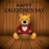 Impresión rellena marrón del juguete del oso de peluche del día de San Valentín en fondo de madera del pecho Foto de archivo