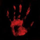 Impresión sangrienta asustadiza de la mano en fondo negro Fotografía de archivo