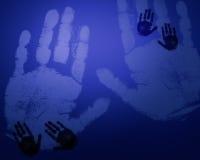 Impresiones azules de la mano Fotos de archivo libres de regalías