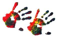 Impresiones de la mano con la pintura de acrílico Foto de archivo