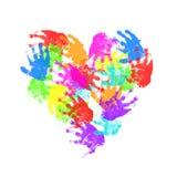 Impresiones de la mano del niño en forma del corazón foto de archivo libre de regalías