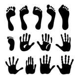 Impresiones de la mano y del pie de la generación Foto de archivo
