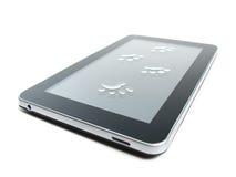 Impresiones de la tableta y de la pata Foto de archivo libre de regalías