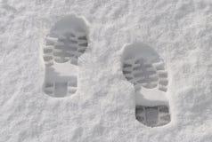 Impresiones del pie en la nieve Foto de archivo libre de regalías