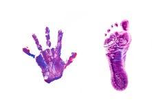 Impresiones pequeños pie y mano del bebé. Fotos de archivo