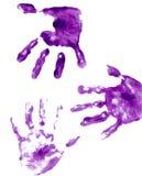Impresiones pintadas púrpuras de la mano Fotos de archivo libres de regalías