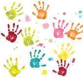 Impresiones planas coloridas de las manos con las manchas blancas /negras de la pintura Imagenes de archivo