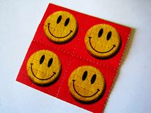Impresiones sonrientes del papel pintado de la bella arte del fondo de la lengua de la etiqueta engomada lsd de la cara fotos de archivo libres de regalías
