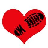 Impressão da sola áspera da sapata no símbolo do amor Fotografia de Stock Royalty Free