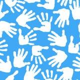 Impressão das palmas e dos pés das crianças s Teste padrão sem emenda Imagens de Stock