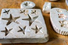 Impressões da argila da estrela do mar Foto de Stock Royalty Free