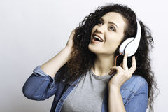 Impressed girl while singing songs Stock Photography