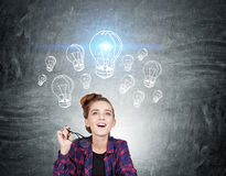 Impressed nerd girl and blue light bulb sketch Royalty Free Stock Image