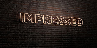 IMPRESSED -Realistic Neon Sign on Brick Wall background - 3D rendered royalty free stock image Royalty Free Stock Photography