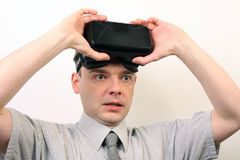 An impressed, relieved, flabbergasted man wearing Oculus Rift VR virtual reality headset Stock Photos
