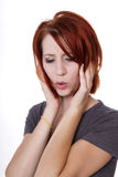 Impressed or Stressed. Redhead woman indicates she is very impressed or stressed stock images