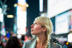 Impressed Woman in the Middle of Times Square. At Night Royalty Free Stock Photography